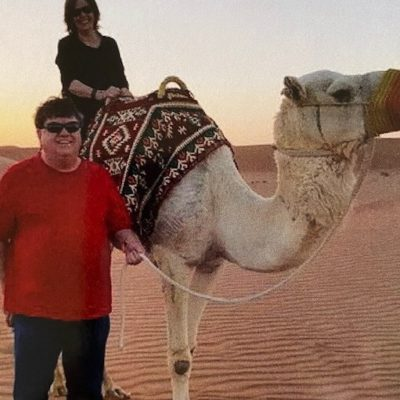 Mom riding a camel in the desert