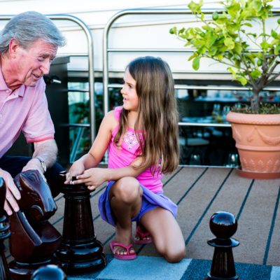 Grandpa and Kid playing chess