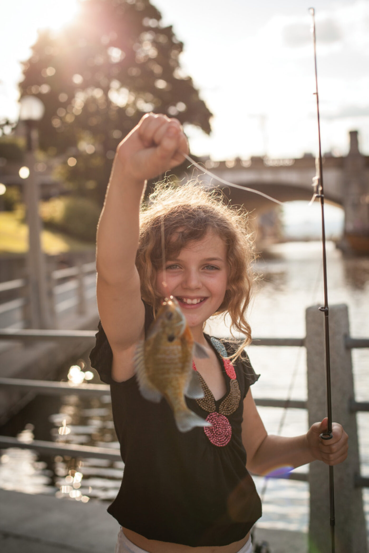 Canada Rideau Canal Girl Fishing Credit Canadian Tourism Commission